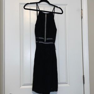 Anna Grace Black dress with cut out accents
